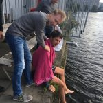 Losing a bet means jumping in the canal behind the office.
